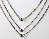 Triple strand heart necklace