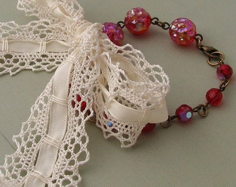 Shabby bracelet with vintage ruby red glass beads and lace bow