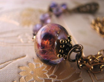 Purple bracelet  with Lampwork and vintage Cardinal  glass