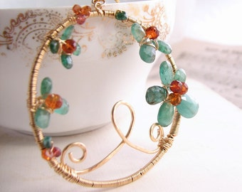 Emerald wire wrapped gold gemstone necklace