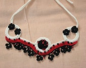 A freeform necklace in black, white and red OOAK