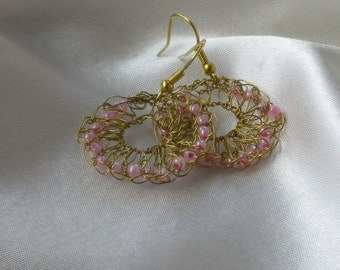Wire knitted earrings with pink glass beads