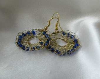 Wire knitted earrings with blue glass beads