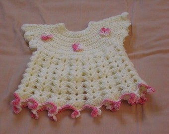 Fancy baby dress with pink knitted flowers
