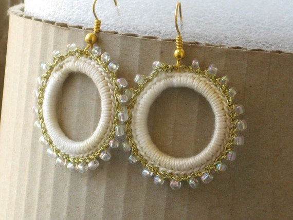 Crocheted hoop earrings with off white shades cotton yarn and gold thread with white glass beads