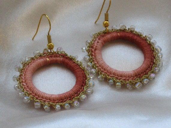 Crocheted hoop earrings with light brown shades cotton yarn and gold thread with white glass beads
