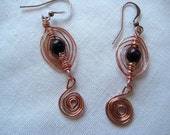 Long Egyptian coil earring in copper and onyx bead- under 20 usd