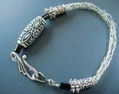 Black and white jewelry - Viking knitted bracelet  in  silver tone an an unusual  and black and white ethenic bead under 40 USD