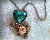 Steampunk jewelry pendant.. On SALE for 2 days only. Handmade Wire Wrapped Antique Finish Watch Parts