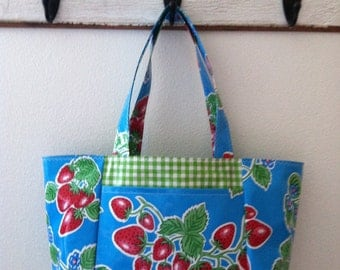 Beth's Large Blue Strawberry Oilcloth Tote bag with exterior pockets