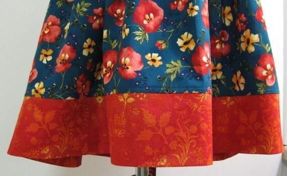 Girls dress/jumper Size 5 Autumn colors on Teal blue background