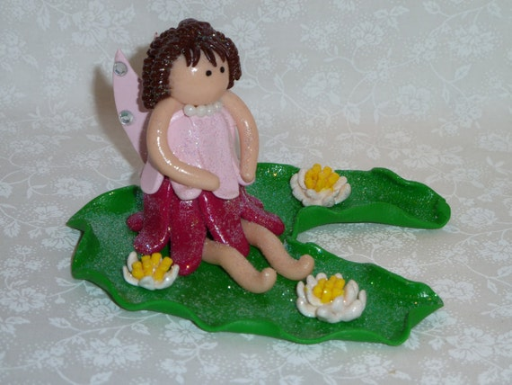 Tooth Fairy Sitting on a Lilly Pad