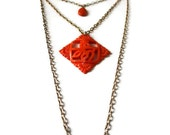 Gold tone layered necklace with tangerine orange Asian inspired pendant