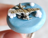 Airplane Ring in Perspective in Pastel Sky Blue Polymer Clay Spring Colors  -Made to Order