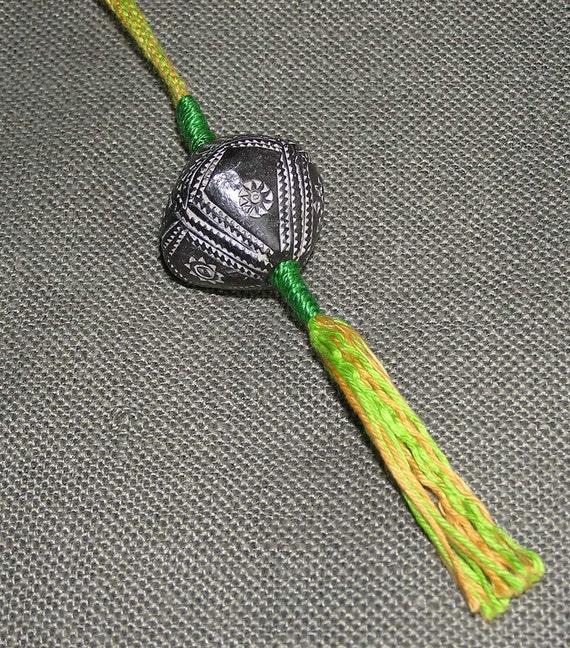 Wristaff - handmade braid with African bead-whorl