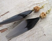 Feather and skull earrings
