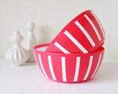Red plastic bowls with white stripes