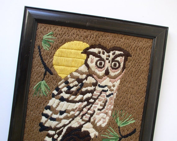 Needlework owl sitting on branch, embroidery