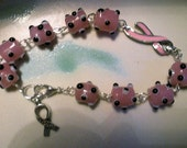 Breast cancer awareness bracelet of bumpy beads and silver ribbon charm