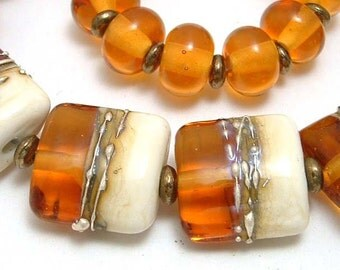 TOPAZ AND IVORY  LAMPWORK BEADS