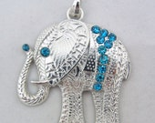 Bright Silver-tone Textured and Turquoise Blue Rhinestone Elephant Pendant