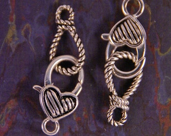 Two Silver-tone Lasso and Heart Toggle Clasps