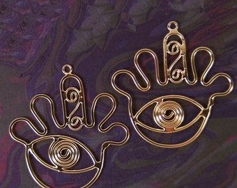 Unique Pair of Gold-tone Outline Eye in Hand Charms