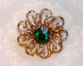 vintage gold tone May birthstone emerald gem floral brooch