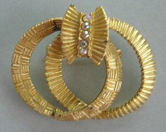 vintage unusual gold tone brooch with aurora borealis rhinestones