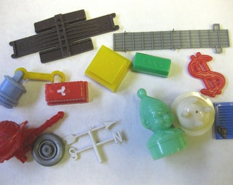13 Vintage Plastic Toy Part Lot Candy Cow Clown Boat Motor House Red Cross Miniature Altered Art Supplies