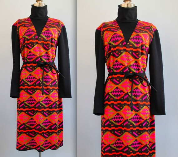 1960s turtleneck dress. Vintage, tribal mod and autumn cozy. Black, orange, pink. Comes with a belt. Size M