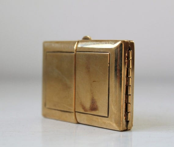 vintage 1940s hinged brass compact or tiny photo keepsake. perfect hiding place.
