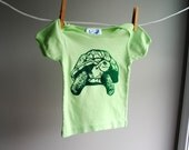 Hank the Happy Tortoise Organic Infant T-Shirt, Hand Dyed Spring Green and Screen Printed with Dark Green Ink, sized 12 to 18 month