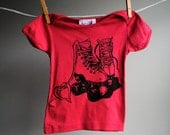 Roller Skate Infant T-Shirt, Organic, 12 -18 months, hand dyed strawbery pink and screen printed in black ink.