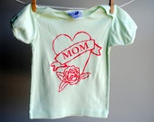 Mom Tattoo Heart T-Shirt, Organic, Pale Spring Green and Screen Printed in Neon Pink Ink, sized 18-24 months.