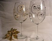 Christmas wine glasses with Gold and Silver swirls with  Swarovski crystals with red and green Swarovski crystals