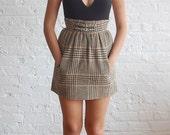 r e s e r v e d .... SALE ... brown houndstooth mini skirt (xs/s)