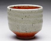 teacup - yunomi with light green celadon and orange shino glazes