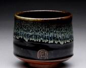 tea cup with black temmoku, wood ash and shino glazes