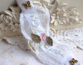 lace and crystal embroidered wristlet with gold charms