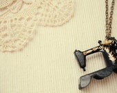 transformed by - a vintage sewing machine necklace.