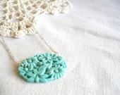 leftover aqua - beautiful aqua floral carved glass pendant.