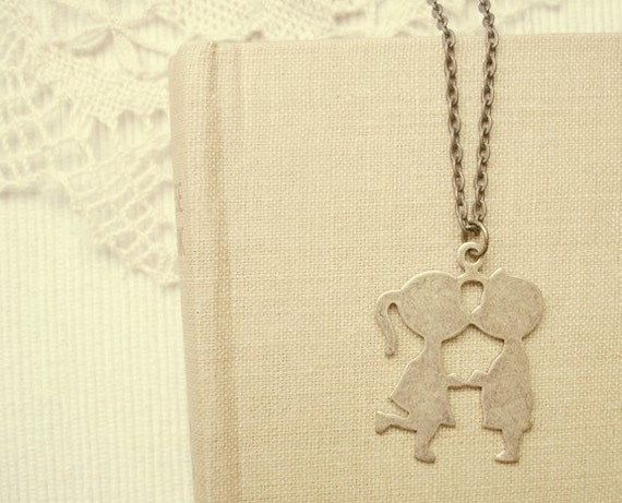 this is love - vintage kissing kids necklace.
