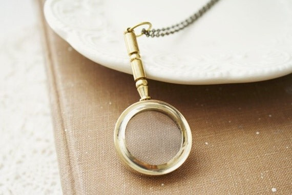 the impressionist - a detective magnifying glass necklace.