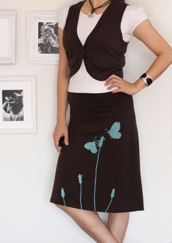 soft jersey knee length brown skirt butterfly s office