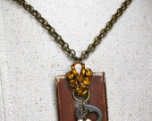 Vintage Key Hole Escutcheon Joined with Salvaged Relics for One of a Kind Necklace- SECURE