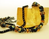 No. 112 Gun metal and black enameled chain necklace with amber beads