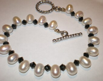Ebony and Ivory Bracelet with matching black earrings