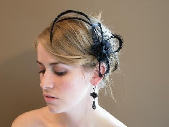 A Striking Birdcage Fascinator Black Flower with Feather Spikes on English Netting