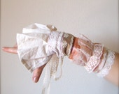 Antoinette. A pair of Decadent gauntlets with lace, ruffles, and layers...